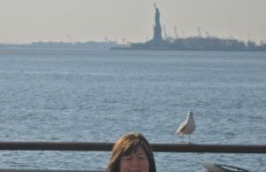 JILL WITH LADY LIBERTY. THIS IS AS CLOSE AS WE GOT BECAUSE WE THOUGHT RIDING THE FERRY WOULD MAKE US SICK. THE BIRD ADDS A NICE TOUCH, I THINK.
